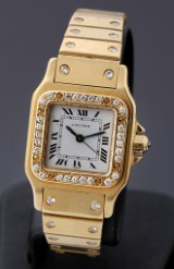 Cartier 'Santos'. Automatic ladies watch, 18 kt. gold, with diamonds