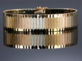 Ottello Bellinaso, Vicenza. Bred retroarmlænke af 18 kt. trefarvet guld, ca. 1960'erne