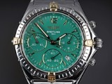 Breitling 'Sextant Chrono'. Unisex watch, 18 kt. gold and steel with green dial, 1990s