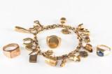 Armlænke med charms og tre ringe
