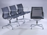 Charles Eames. A set of four armchairs, Model EA-108, in black mesh (4)