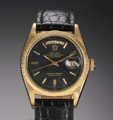 Rolex 'Day-Date'. Herreur i 18 kt. guld med sort skive, ca. 1972