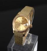 Rolex Oyster perpetual af 18 k guld, damearmbåndsur