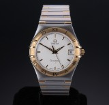 Omega 'Constellation' men's watch, 18 kt. gold and steel, pale dial with date, 2000's