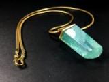 Serpentine chain featuring aquamarine pendant in gold (2)