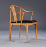 Hans J. Wegner. 'The Chinese Chair', cherry lounge chair, 'Red Label' cushion in black leather