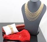 Cartier 18k `Draperie` necklace and bracelet total 129gr