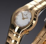 Tag Heuer 'Alter Ego'. Ladies watch, 18 kt. gold, with diamond mother of pearl dial, 2000s