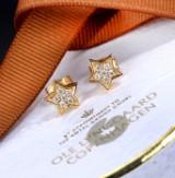 Ole Lynggaard. Et par 'Stars' brillantørestikker af 18 kt. guld. (2)