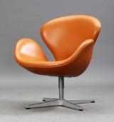 Arne Jacobsen. The Swan easy chair, cognac-coloured leather