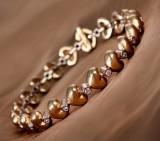Ole Lynggaard. Heart bracelet, 18 kt. gold with diamonds