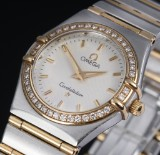Omega 'Constellation'. Ladies' watch in 18 kt. gold and steel with diamonds, c. 1998