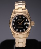 Rolex 'Datejust'. Vintage ladies watch, 18 kt. gold with black dial with diamonds, c. 1979
