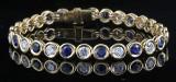 Diamant og safir armbånd i 18kt ca.. 2.80ct <br>