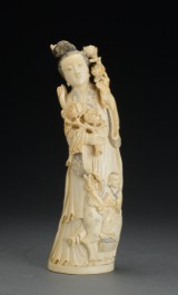 A large Chinese figure, ivory, woman with boy, 20th century
