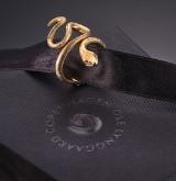 Ole Lynggaard. 'Snake' diamond ring, 18 kt. satin-finish red gold, size medium