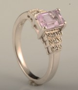 Ring with a amethyst and cubic zirconia