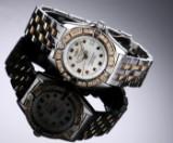 Breitling 'Callistino'. Dameur i 18 kt. guld og stål med perlemorsskive og brillanter, 2000'erne