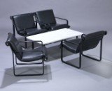 Bruce R. Hannah & Andrew Ivar Morrison for Knoll International. A set of four lounge chairs as well as a sofa table. (5)