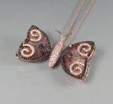 Rose gold necklace featuring tourmalines and diamonds