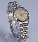 Rolex Datejust. Ladies watch, 18 kt. gold and steel with satin-finish champagne-coloured dial, c. 1987