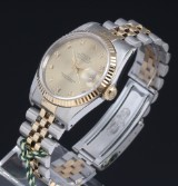 Rolex 'Datejust'. Men's watch, 18 kt. gold and steel, with diamond dial, certificate 1991