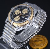 Breitling 'Chronomat'. Men's watch, 18 kt. gold and steel, with black dial, 1990s