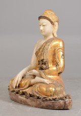 A large seated Buddha, alabaster with gilding and glass stones, Mandalay, Burma, c. 1900