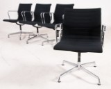 Charles & Ray Eames, set of four armchairs from the 'Aluminium Group' series model EA 108 for Vitra, black hopsack (4)