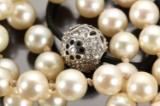 Ole Lynggaard. Clasp, model 'Blonde', with diamonds, 0.63 ct., with accompanying pearl necklace (2)