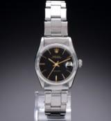 Rolex 'Oysterdate Precision'. Vintage midsizeur i stål med sort skive, ca. 1960