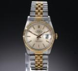 Rolex 'Datejust'. Herreur i 18 kt. guld og stål med lys skive, ca. 1989