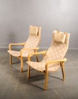 Yngve Ekström. Two easy chairs, moulded beech, plaited straps, Swedese (2)