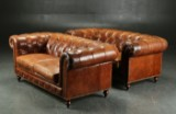 A pair of sofas, Chesterfield form. Deep-buttoned cognac leather (2)