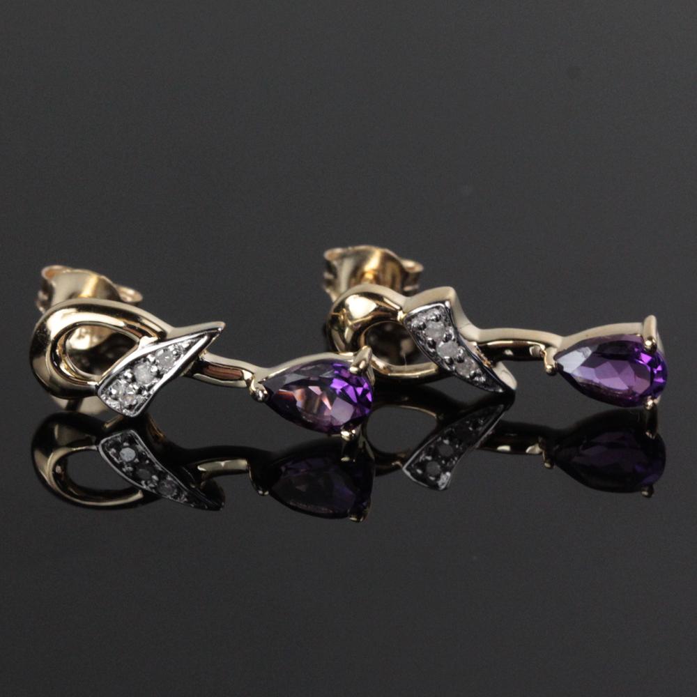 Par ametyst og diamant ørestikkere i 14 kt. guld - Par ametyst og diamant ørestikkere i 14 kt. guld prydet med 2 stk. ametyster samt seks mindre single cut diamanter. højde ca. 18,5 mm