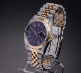 Rolex Datejust. Men's watch, 18 kt. gold and steel, 1989