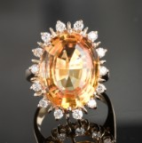 Rose gold ring featuring brilliant-cut diamonds and citrine