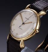 Jaeger LeCoultre for Cartier. Vintage men's watch, 18 kt. gold, c. 1950s