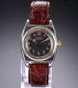 Rolex 'Oyster Imperial Chronometre'. Vintage herreur i stål med sort skive, 1950'erne