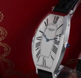 Cartier 'Tonneau Cintrée'. Unisex platinum with original strap and clasp