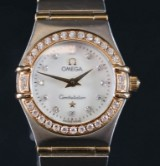 Omega 'Constellation'. Ladies' watch in 18 kt. gold and steel with diamonds, 0.32 ct.