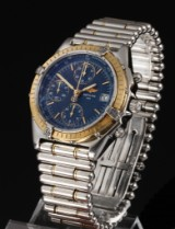 Breitling 'Chronomat'. Men's chronograph, 18 kt. gold and steel with date