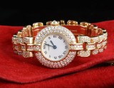 Cartier diamond and gold watch.