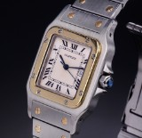 Cartier 'Santos'. Men's watch, 18 kt. gold and steel with date, 1990s