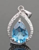 Diamond and topaz pendant in gold approx. 0.10ct