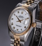 Rolex 'Datejust'. Men's watch, 18 kt. gold and steel, white dial, c. 1994