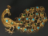 A filigree brooch in the shape of a peacock