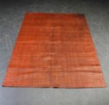 Tæppe af flettet læder
