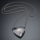A large diamond pendant with chain, approx. 1.25 ct