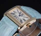 Cartier 'Devan'. Ladies watch, 18 kt. gold, with original gold clasp